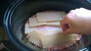 10.  Layer in about 5 noodles, breaking them as necessary to cover the sauce and fit the pot.