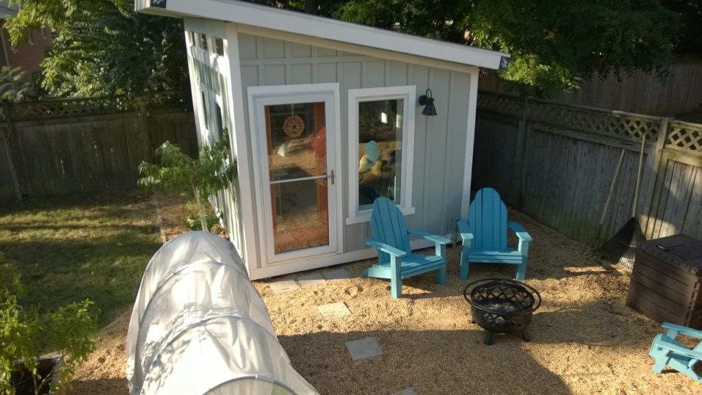 2016 Update:  pea gravel 'patio' and Adirondack chairs